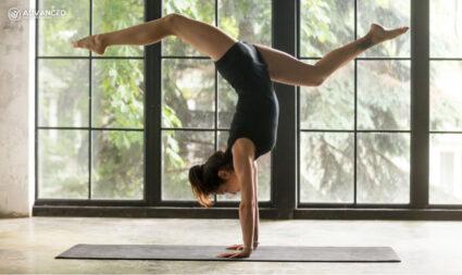 woman doing yoga and balancing weight on wrist